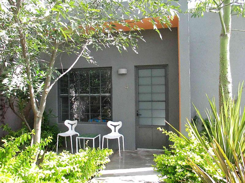 Entry to Tulipan casita with private patio in garden.