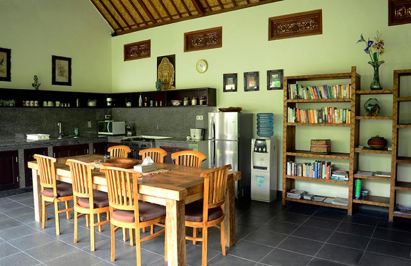 The dining area is large enough for entertaining. It sits beside the kitchen.