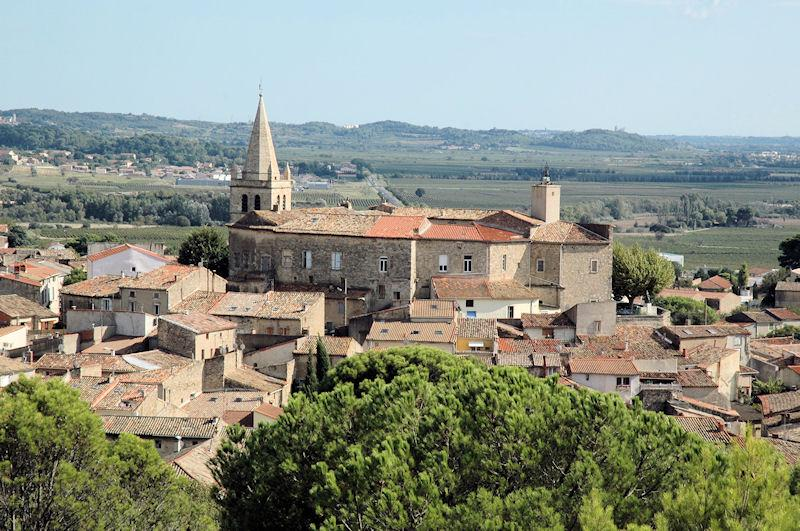 The castle and church in Murviel lès Béziers the house on the right side