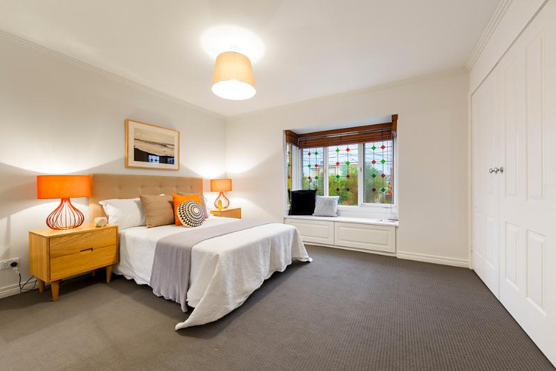 Spacious main bedroom with built in robes and natural light