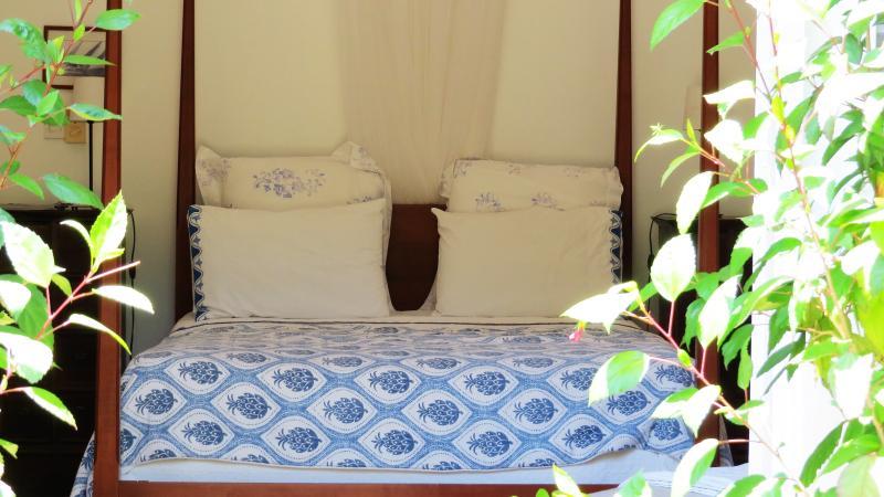 4-poster bedroom with door to pool and garden.