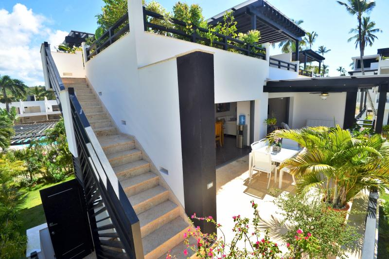 Stairs to the rooftop terrace with jacuzzi