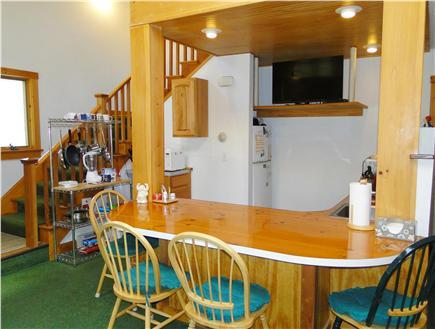 Open Great Room...view of kitchenette & British Bar area...with stairs to 2nd floor...