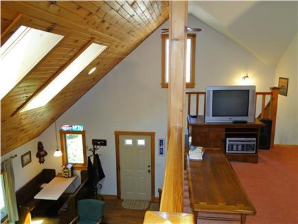 Loft with TV...& Full Futon bed.  Open to 1st floor & dining booth from local historic pizza place!