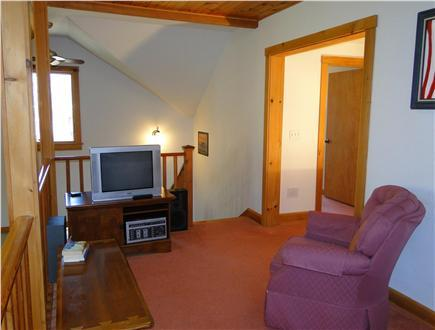 View of loft seating & TV & stereo