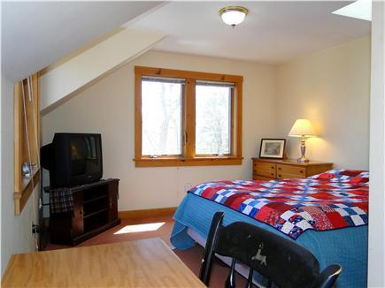 Master bedroom with Queen bed under stars & skylight!  Large TV & desk - access to big bathroom