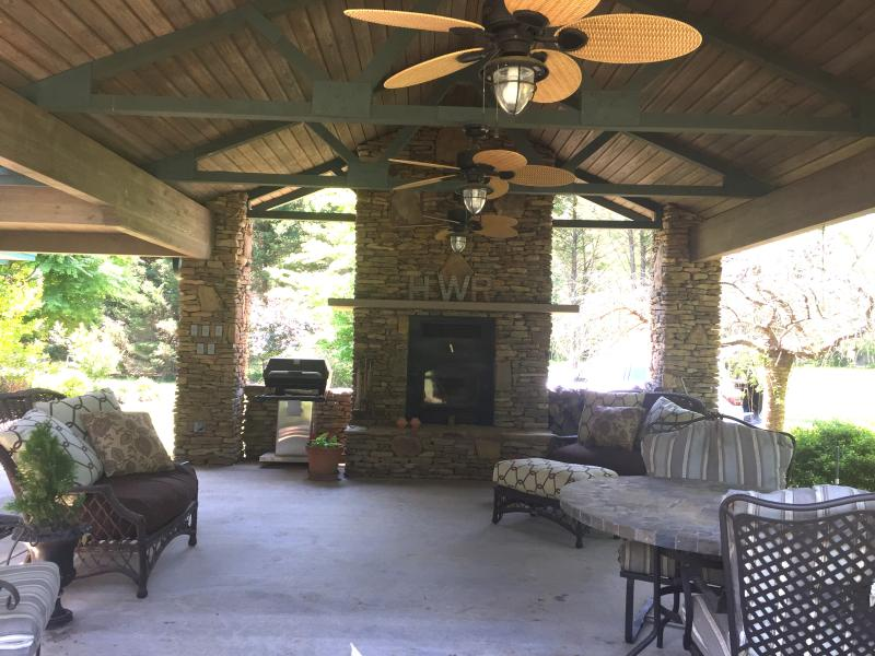 Natural stone outdoor fireplace to relax by