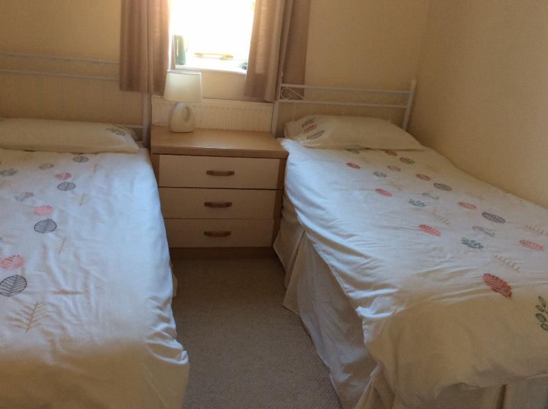 Two single beds double wardrobe