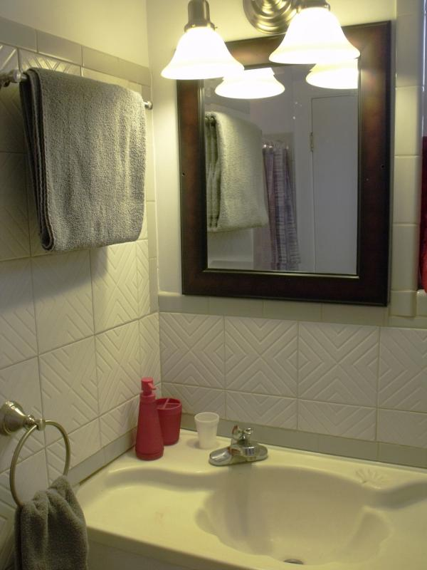 A sizable bathroom with soft, fresh towels awaiting your arrival.