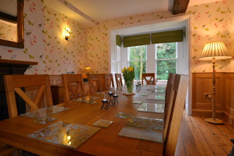 The elegant oak-panelled dining room. Ideal for a meal together or special celebration.