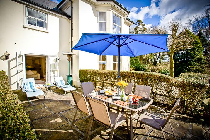 patio with table and chairs bbq and sun loungers seating for 6 persons