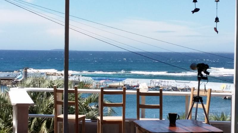 Just in front of a peaceful ocean,  cafe / meeting room / dining area with ocean breeze.
