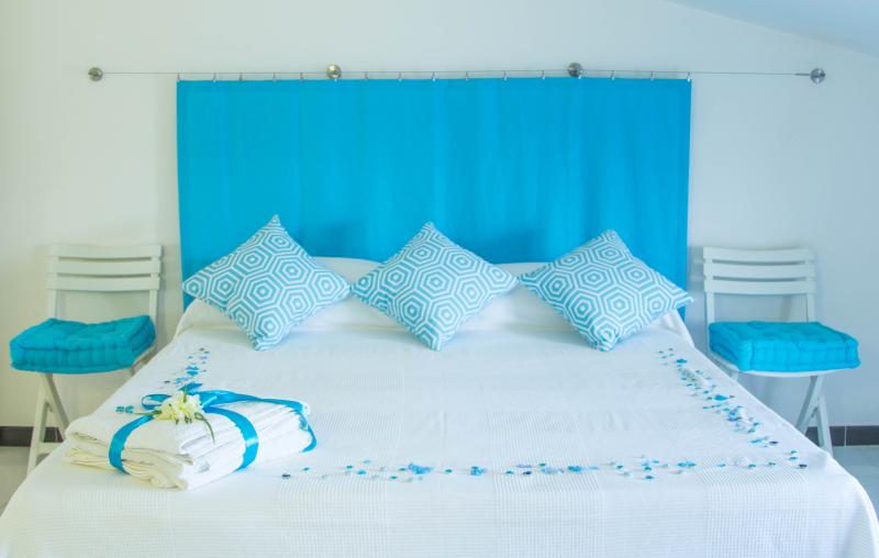 Light Blue Room - memory cushions and bed frame with wooden slats