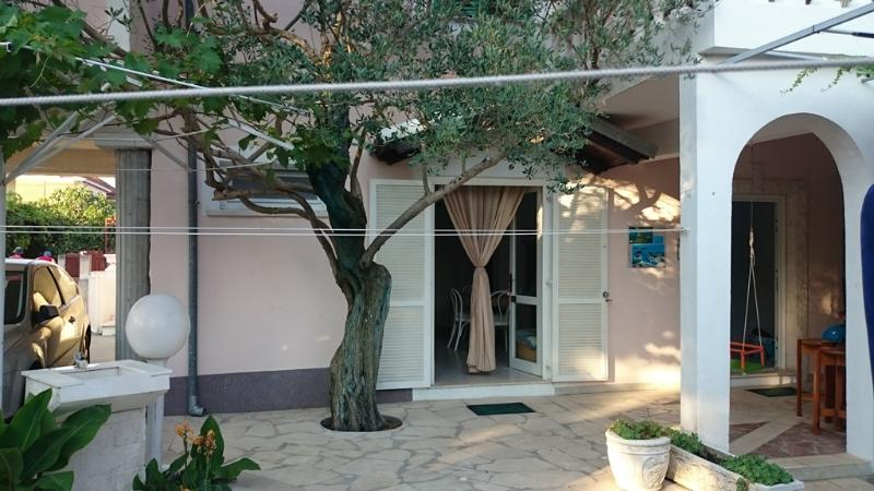 House is in a quiet little street, only 200 m straight road from the beaches and center of Rogoznica