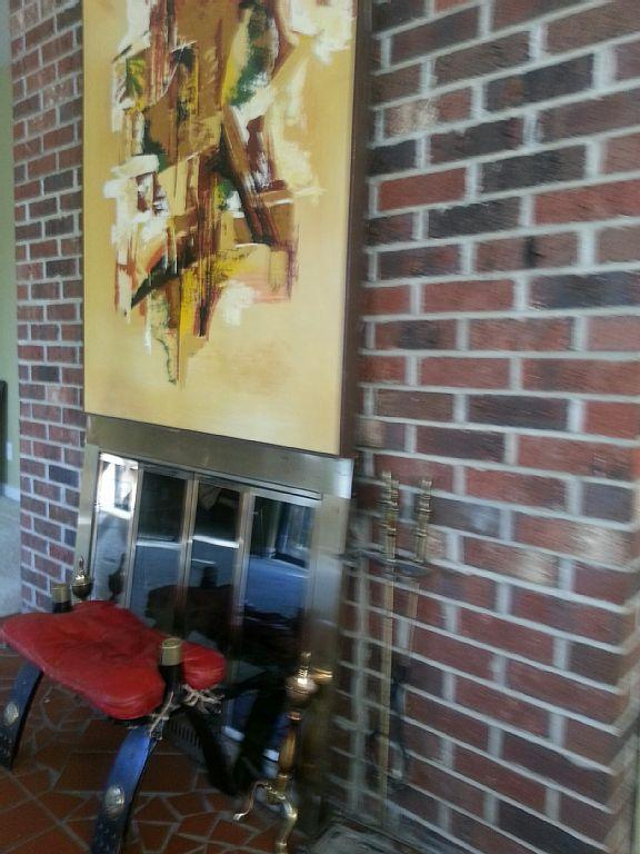Fireplace with original large canvas picture, view of Potomac river