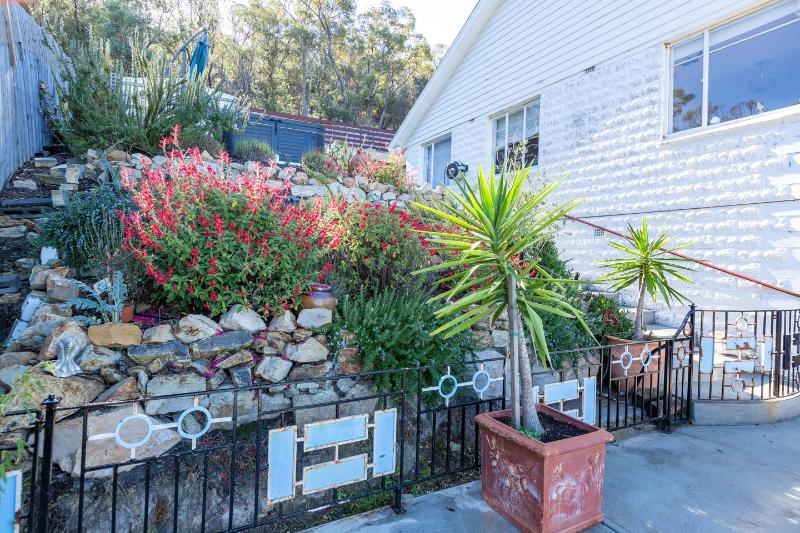 Your brand new garden terrace awaits, wild bush behind the house with a fab flat walking track
