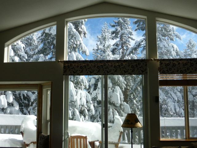 View through Family Room to Pyramid Peak . Back deck has BBQ, Large Table for Meals and fire pit.