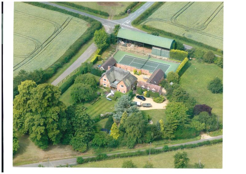 Aerial view of Farm. Middle Wymson House is the T shaped building adjoining the tennis court.