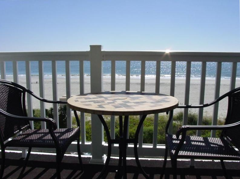 Enjoy sitting on the balcony and soaking up the oceanfront view.