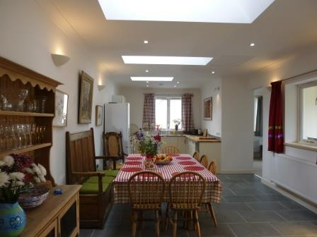 Dining area showing kitchen and through to living room