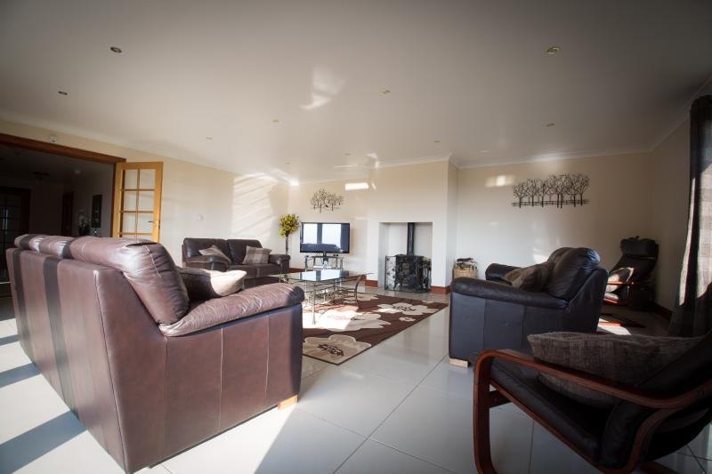 large lounge with underfloor heating & log burner (logs provided)  doors onto patio fantastic views