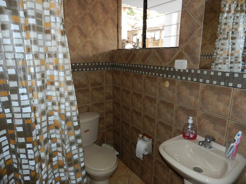 full bathroom with shower shared bedrooms II ° III ° with two single beds each