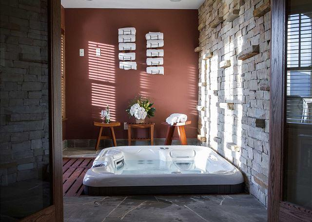 Indoor hot tub beside downstairs recreation room