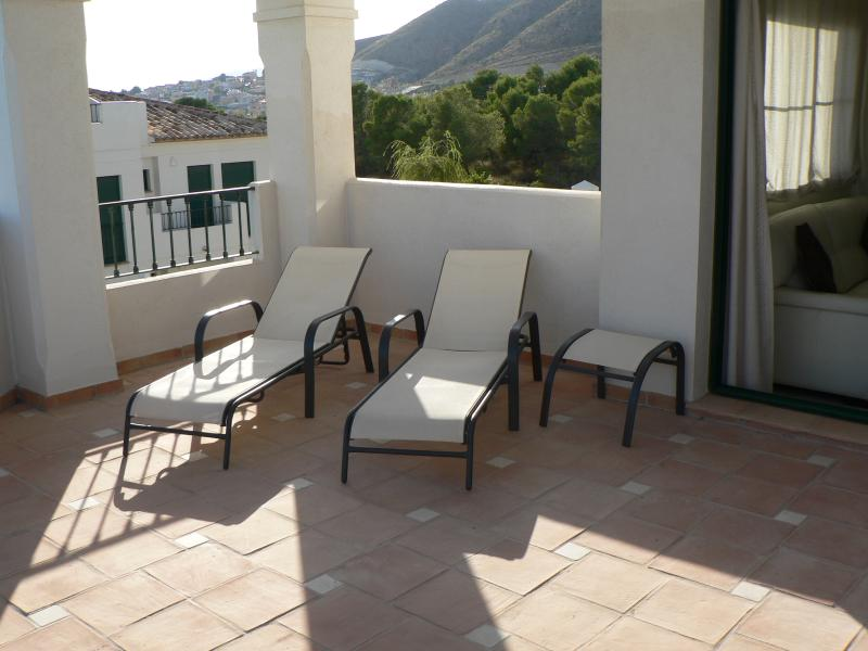 Sunloungers on large roof terrace