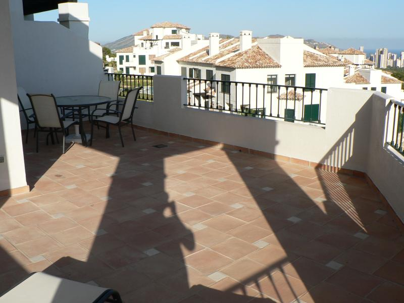 Large roof terrace with outdoor table and chairs