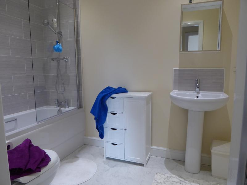 Bathroom is very roomy with thermostatic shower over bath