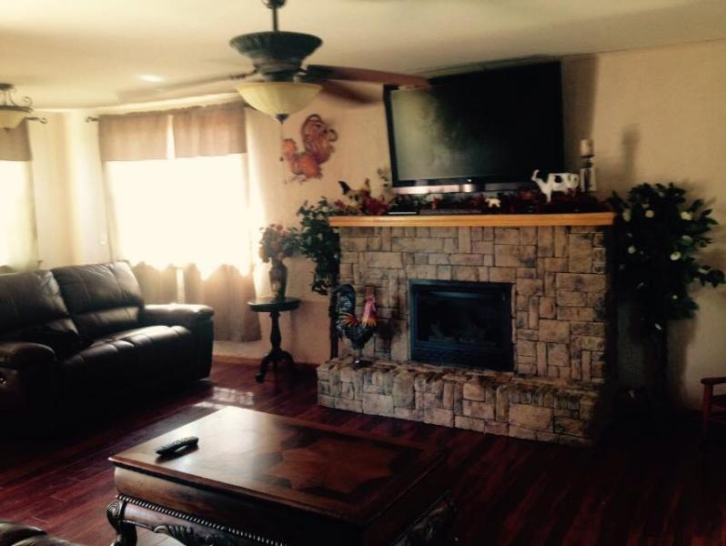 Living room w/gas fireplace and Direct TV