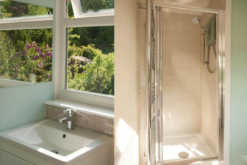 bathroom with a garden view and contemporary walk in glass and chrome shower
