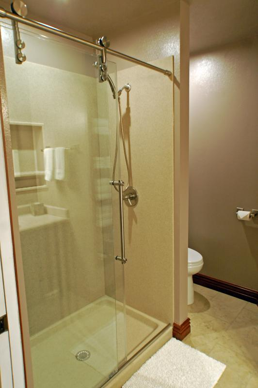 One of the two glass showers on the upper level.