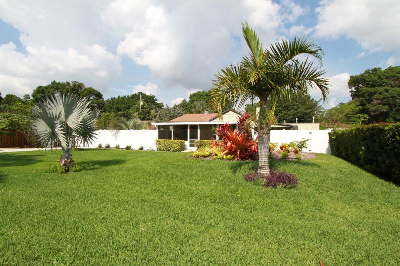 Large open front yard with lush grass to play catch