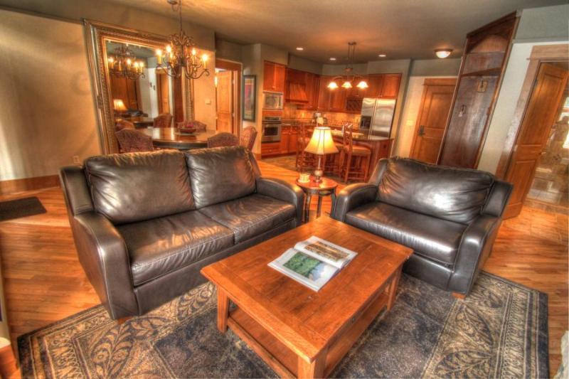 Living Room - Leather furniture and hardwood floors.