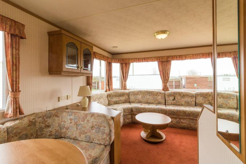 Lounge area with attached dining area at Lees Holiday Park.