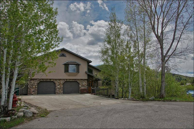 Large, Open Kitchen with Granite Counters, Stainless Steel Appliances, & Butcher Block Island.