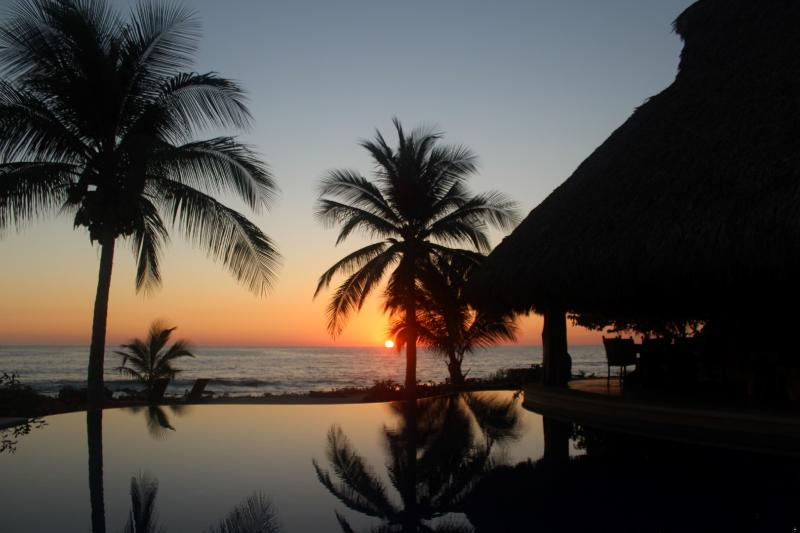 Casa Maya sunset from the pool and palapa