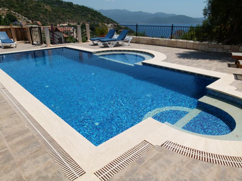 General View of the Pool towards the Mediterranean Sea with wide sunbathing terraces.