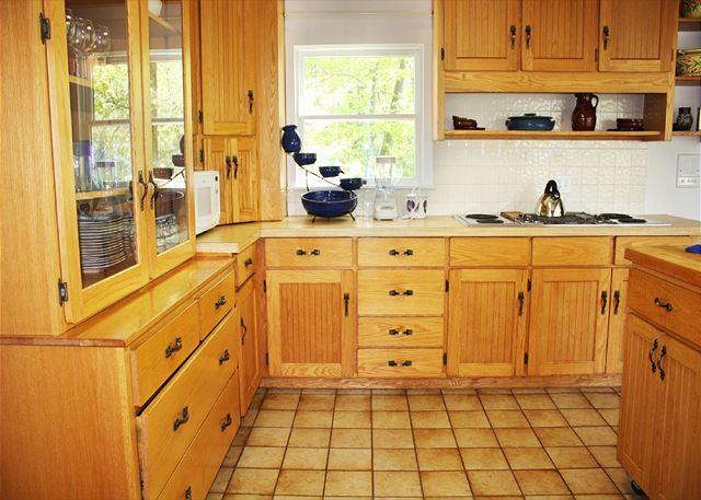 Kitchen has plenty of oak cabinets.