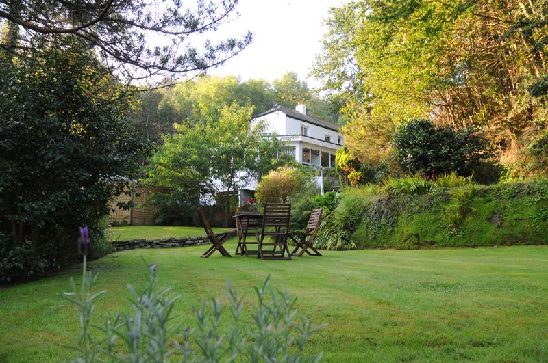 whilst overlooking the tranquil woodland set garden.