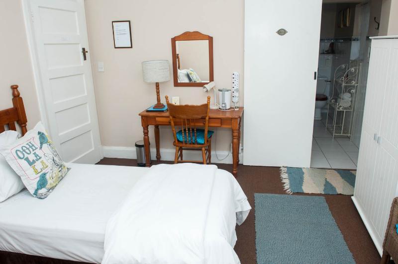 Blue bedroom with en-suite bathroom.
