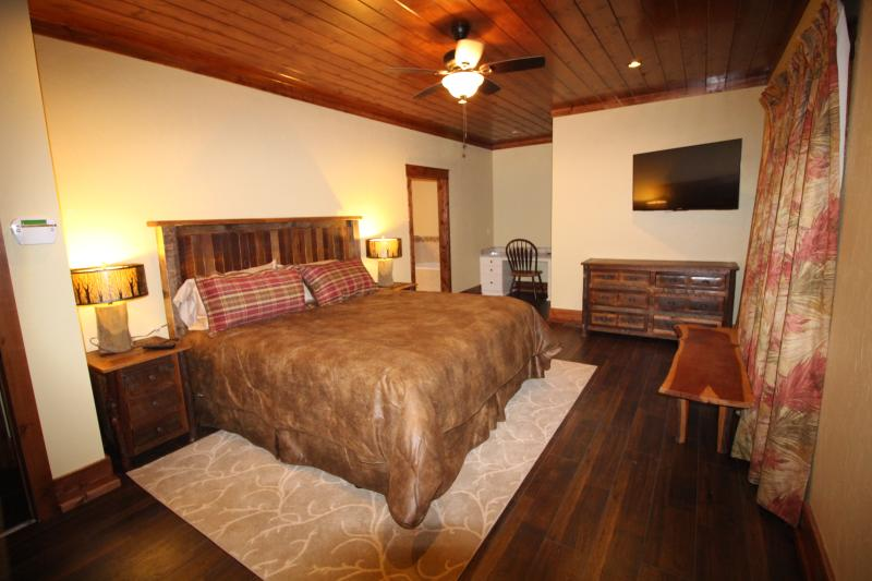 Grand Master bedroom on the main floor - King Bed, guest closet, make up vanity - Direct TV