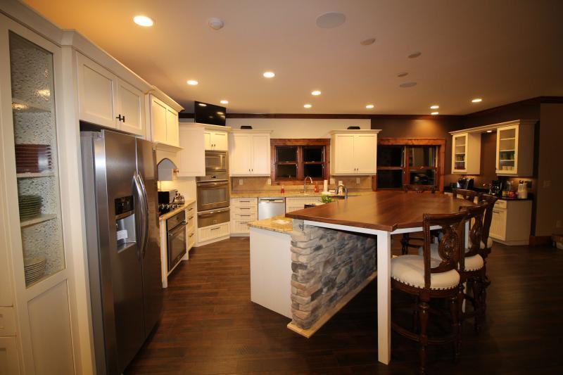 Large kitchen with eating island - double ovens, double dishwashers, ice maker, fridge, coffee bar.