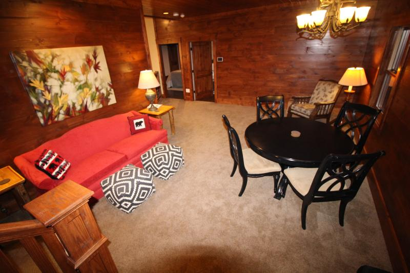 Cozy Loft on the second floor between the 4 upstairs bedrooms - game/puzzle table and reading chair.