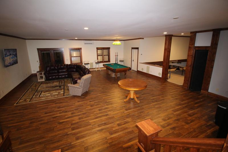 Spacious basement with Pool Table, Ping Pong, Game Table, 65' TV with sitting area, & Kitchenette