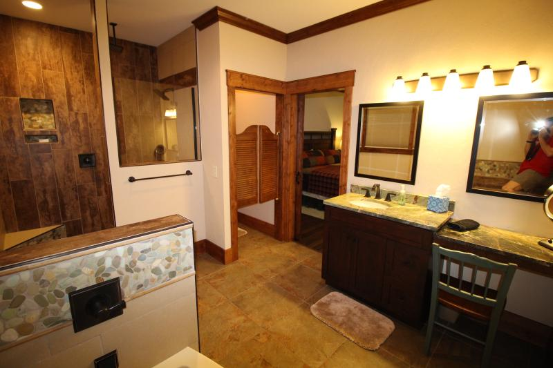 Master bathroom #1 with Walk in shower, tub, water closet, Vanity seat with lighted makeup mirror.