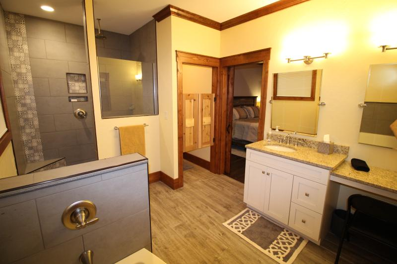 Master bathroom #2 with Walk in shower, tub, water closet, Vanity seat with lighted makeup mirror.