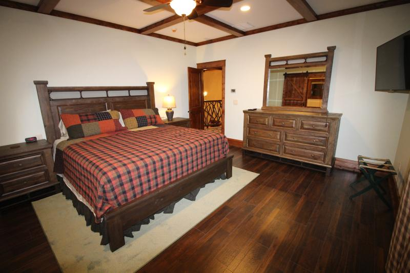 Master bedroom #1 on 2nd floor - King bed, DirecTV, Full bathroom.