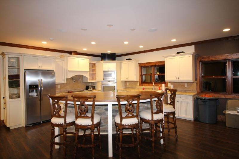 Another view of the spacious and fully equipped kitchen.